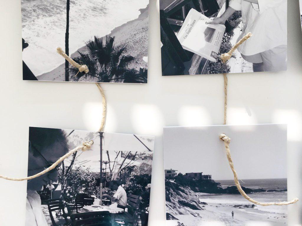 Mehrere Fotos mit Chnüren verbunden. eine schöne Wanddekoration.