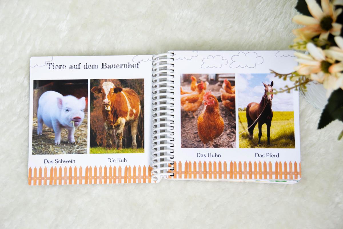 Doppelseite im Fotobuch mit Bauernhoftieren