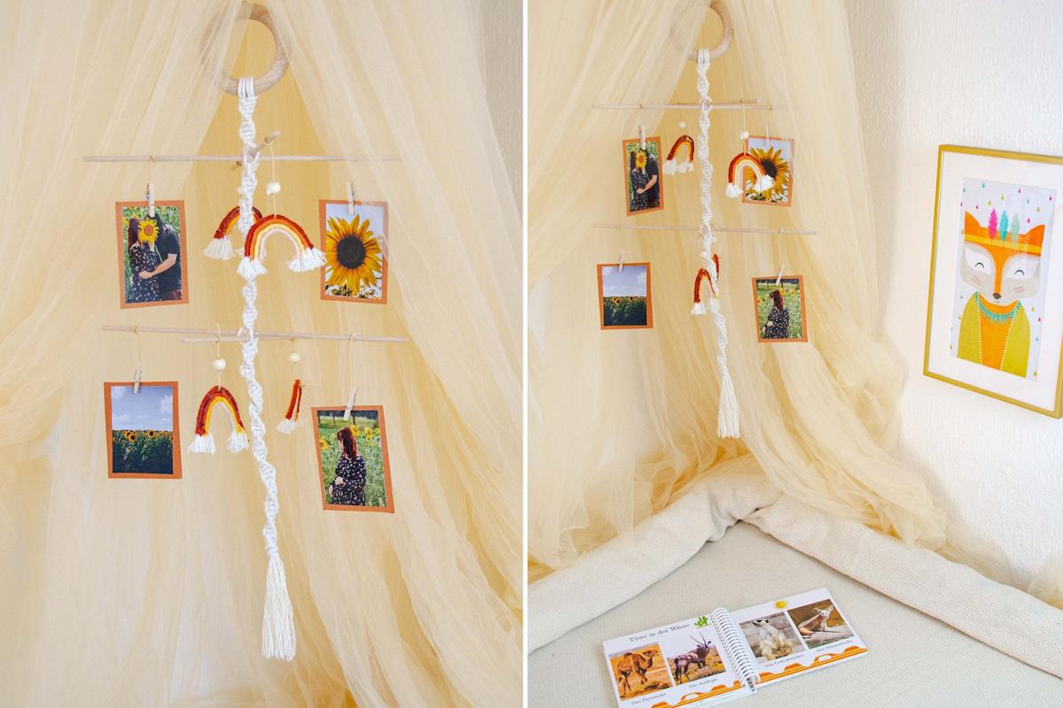 Das fertige Mobile aus Baumwolle an einem Holzring mit Fotos an Querstangen und Regenbögen aus Baumwollgarn