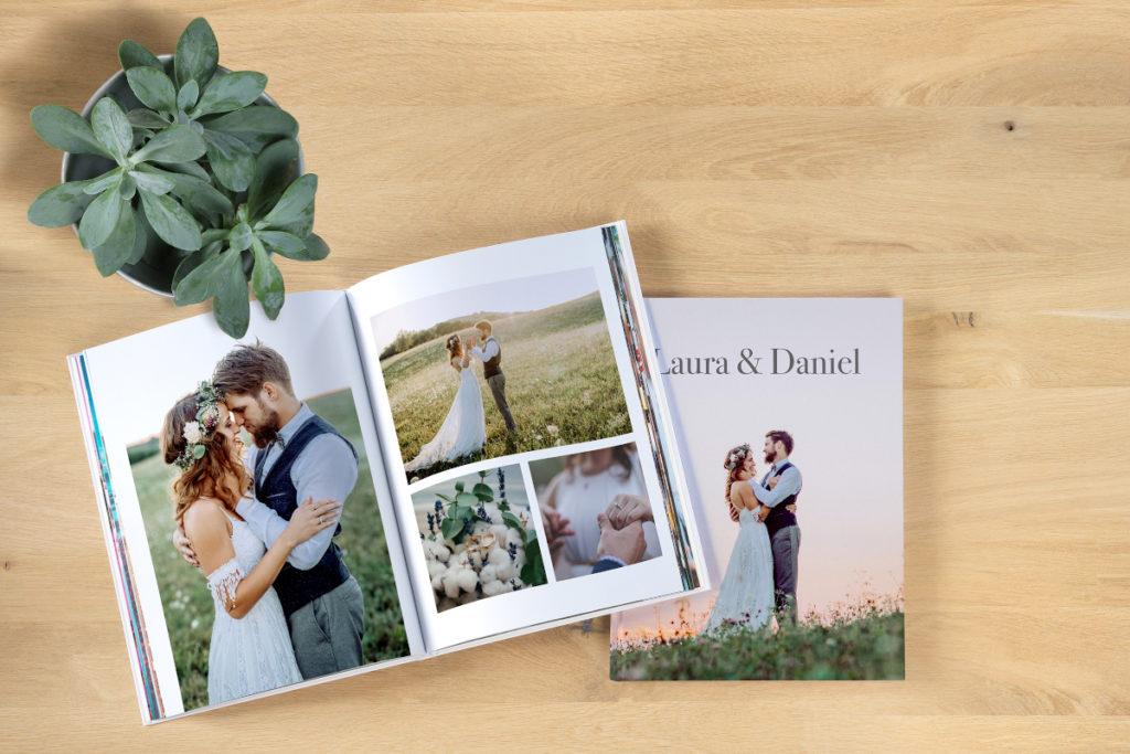 Pixum Fotobuch mit Hochzeitsbildern auf Tisch