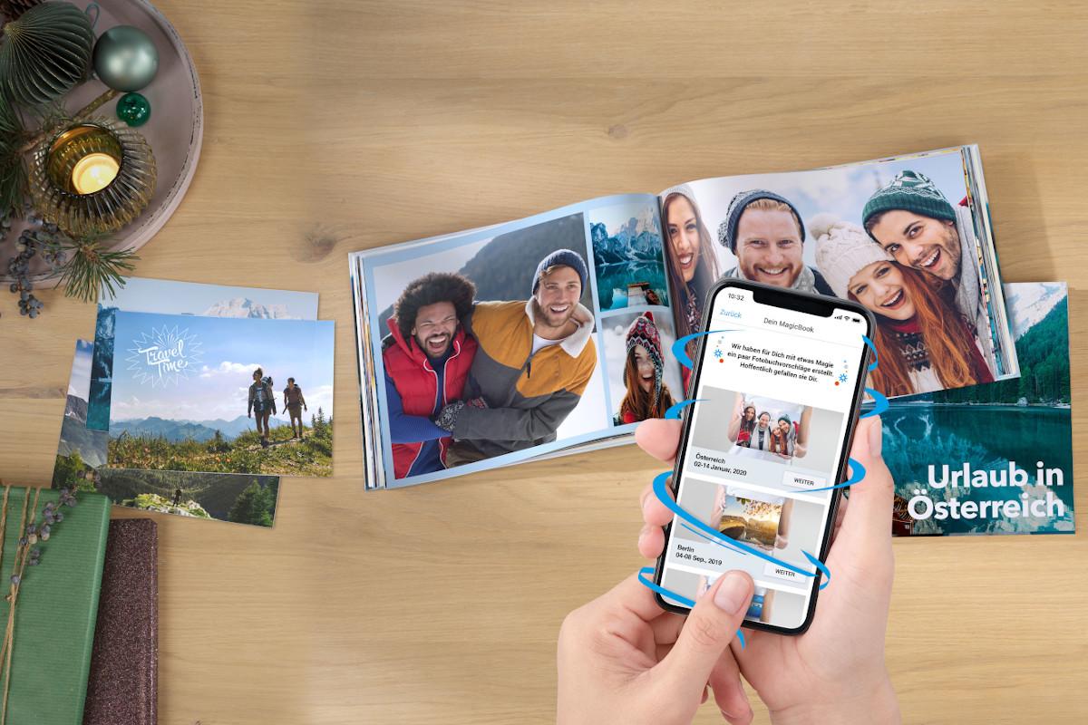 Pixum Fotobuch, Fotoabzüge und ein Smartphone